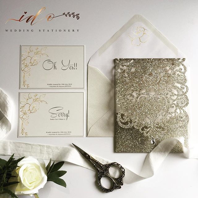 Champagne gold laser cut folder, with gold foil floral details printed on ivory card. A beautifully formal and elegant Wedding Invitation for your guests-online
