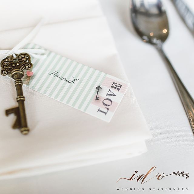 Guest Table name cards don't have to be 'just a card' Think about an option that includes an item they can save as a keepsake from your day. This Tag on a key would look lovely hanging on a hook in their home, to remind them of the most beautiful day spent at your wedding-online