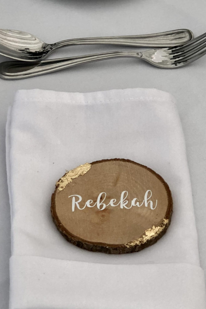 Guest name on wood slice with gold leaf