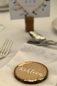 Guest Name on woodslice and gold leaf